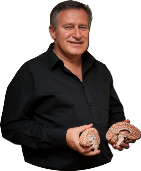 Dr. Andre Vermeulen wearing a black shirt smiling while holding a model of the brain