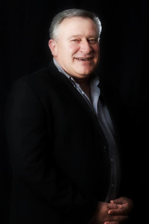 Image of Dr. Andre Vermeulen in a black blazer