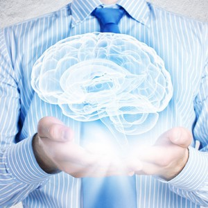 Photo illustration of a man holding a 3D hologram of a brain in both hands with the Neuro-Link logo in the brain (Neuro-Link LRP advanced + brain profile branding picture)