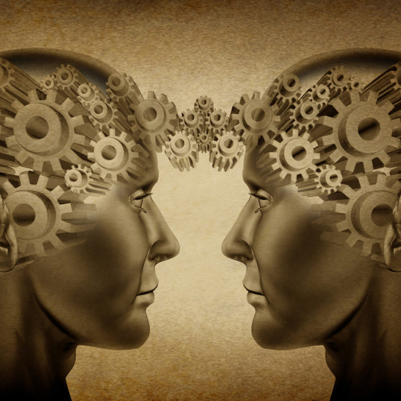 Two head Linked together by gears (Neurocoaching branding image)