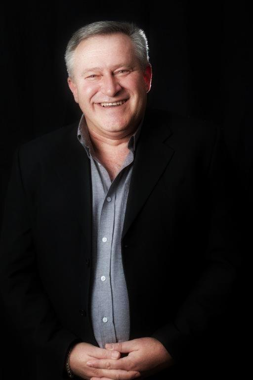 Image of Dr. Andre Vermeulen smiling in a black blazer