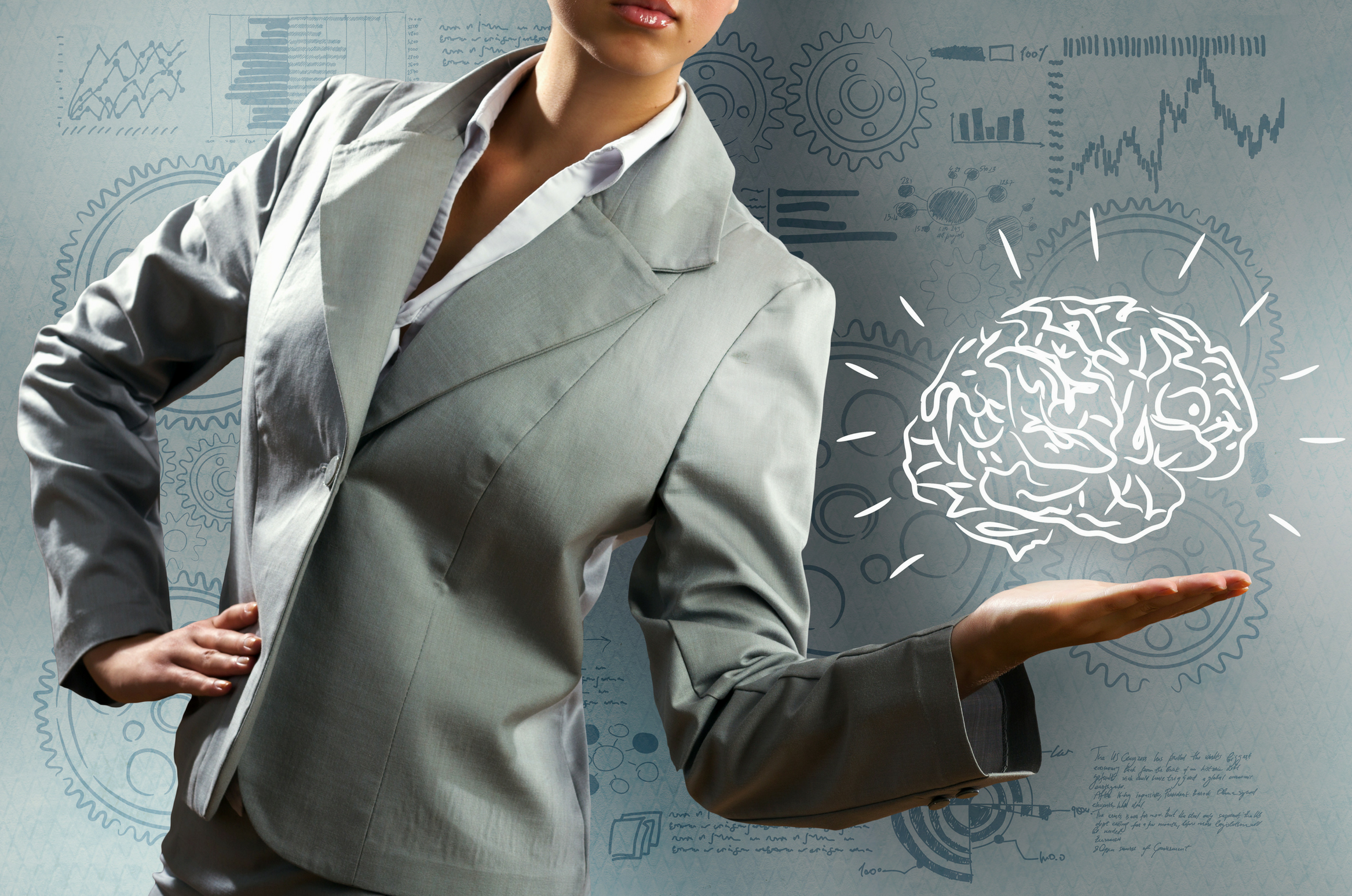Woman standing with a picture of a brain above her left hand