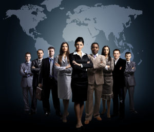 Group of people standing in front of a world map (Leadership development branding picture)